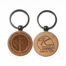 keychain made of natural beech wood with the blessing logo of the 2019 helmets engraved on one side and the sanctuary on the other.
